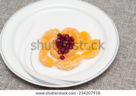 Orange mandarin or tangerine fruit. Orange Peeled and sliced.