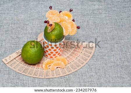 Orange mandarin or tangerine fruit. Orange Peeled and sliced.peacock made of orange. Food art.\ Food decoration