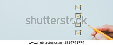 Orange marking on checklist box, Checklist concept, copy space Photo stock ©