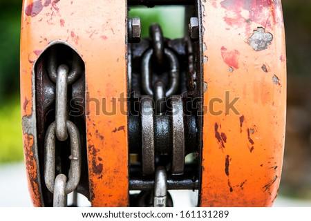 Orange metal hoist
