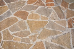 Orange old stone road surface. Seamless Texture. The texture of a stone road. High quality photo
