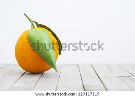 orange on old wooden table