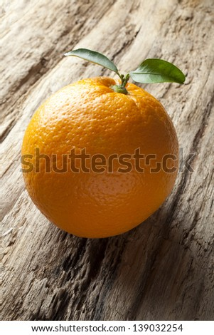 orange on wooden rustic background.