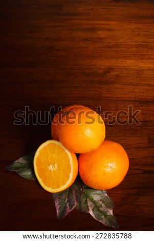 Orange on wooden table and water drop on skin fruit.