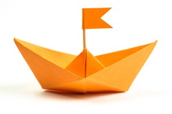Orange origami paper boat isolated on white