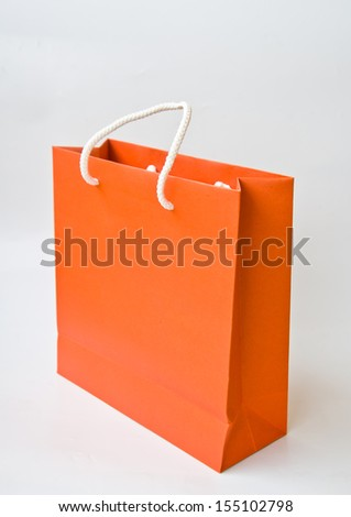orange paper bag on white background - stock photo