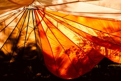 Orange parachute in the summer sun at a Boy Scout Campout at Ratcliff Lake Recreational Area, Kennard, Texas