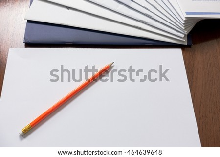 Orange Pencil and paperwork with reports arranged on wooden table. #464639648