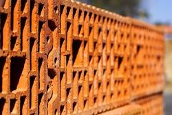 Orange perforated brick blocks, close-up