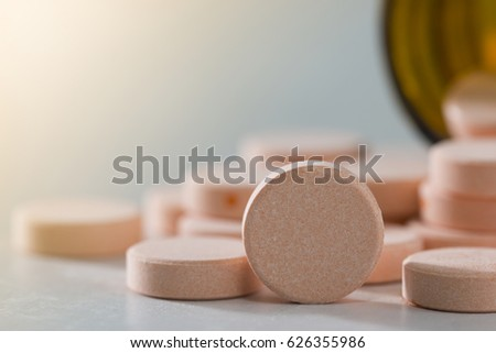 Orange pill or capsule on background with copy space Prescription for medicines Medicines in healthy containers antibiotics