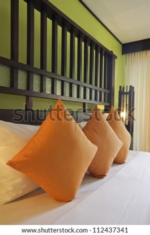 Orange pillow on bedroom
