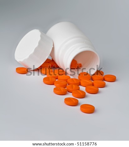 Orange pills and white bottle