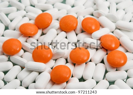 orange pills close-up on medicines