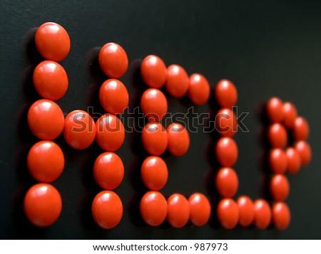 orange pills word on black