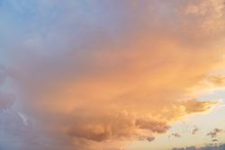 Orange pink evening sky just after sunset - afternoon clouds background