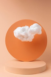 Orange podium with cloud on pastel background. Concept scene stage showcase, for product, promotion, sale, banner, presentation, cosmetic and fashion. Minimal showcase mock up concept.