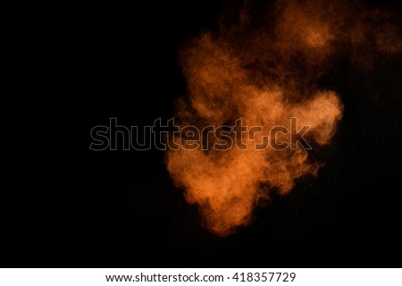 Orange powder explosion on black background. Colored powder cloud. Colorful dust explode. Paint Holi. #418357729