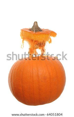 Orange pumpkin  isolated on a white background with its top floating above it in mid air.