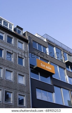 Orange real estate sign. Sign on a balcony of a modern apartment house.