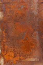 Orange red old rusty metal surface. An oxidized weathered patina with a copper color, texture and structure. Vintage material effect
