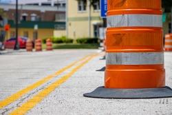 Orange road construction barrel barrier on city street