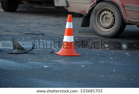 Orange road hazard cone on accident site  #533685703