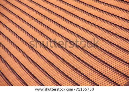 orange roof from carved tile, pattern of tile on the roof