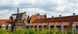 orange roof tiles and Sint Elizabeth Church. Fortified city Grave,  The Netherlands