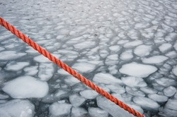 Orange rope in front of ice formations, Norway.