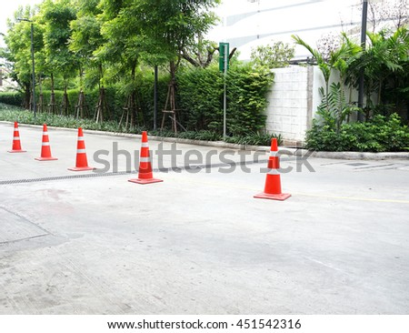 Orange rubber traffic cone on road #451542316