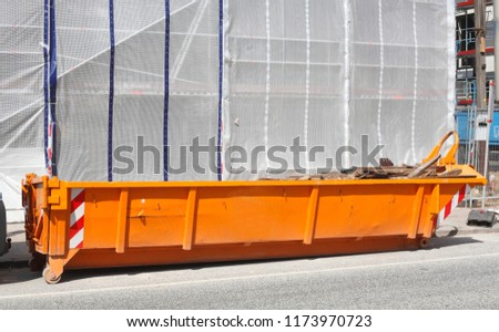 orange Rubble Container on the street