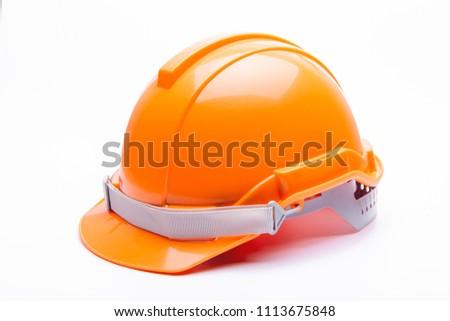Orange safety helmet construction on white background