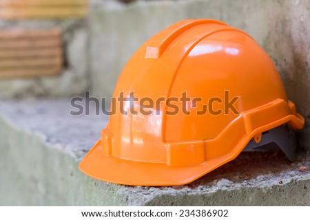 orange safety helmet, safety equipment of construction worker