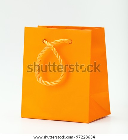 Orange shopping bag on white.