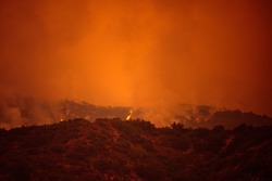 Orange sky over the mountains of California. Fires near Los Angeles. Smoke pollution in US air