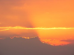 orange skyscape background with god rays