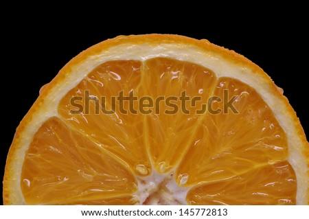 Orange slice against solid black/Orange Sunrise