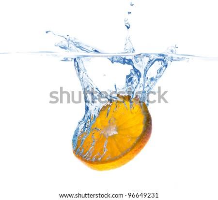 orange slice in water splash