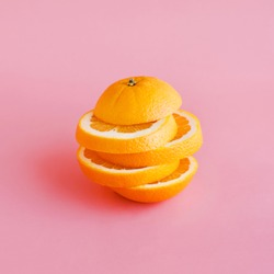 Orange slice on pastel color background.Summer and healthy concept idea