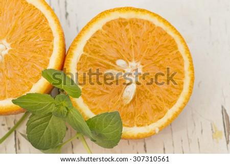 Orange slices and mint background