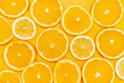 Orange slices on yellow background