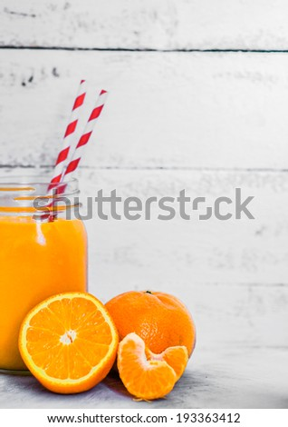 Orange smoothie on rustic background #193363412