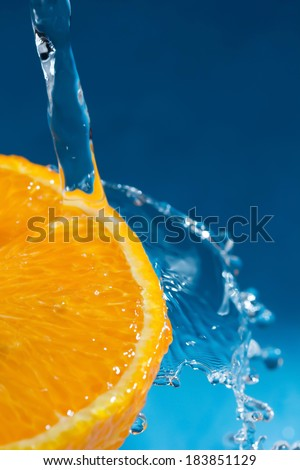 Orange splash Blue background