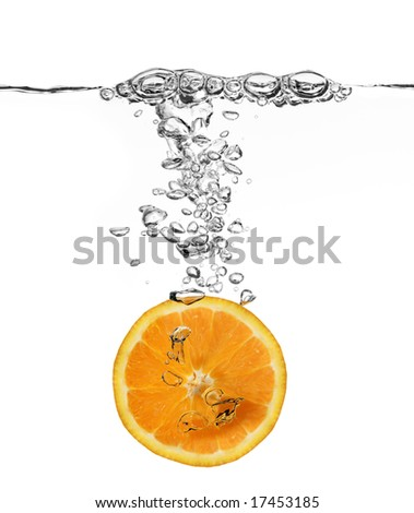 orange splash in water isolated on white