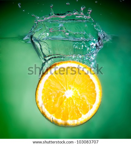 orange splash into fresh water