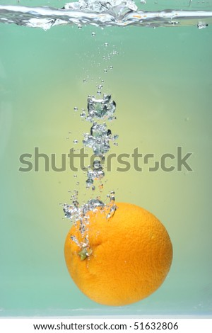 Orange Splash on green background