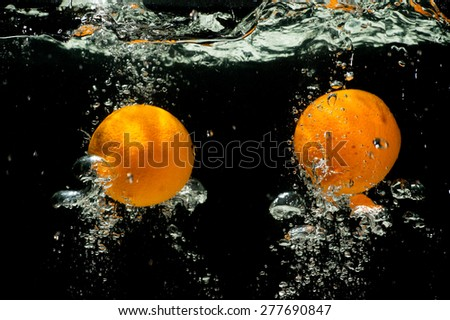 Orange Splash Under water , Fresh Fruit