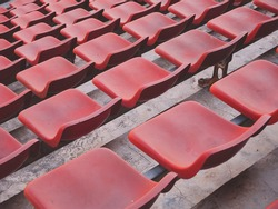 orange stadium seats close up