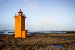 Orange Stafnesviti lighthouse tower building in Stafnes Reykjanes Southern Peninsula Reykjanesskagi Iceland Europe