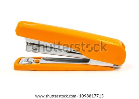 Orange stapler on a white background.